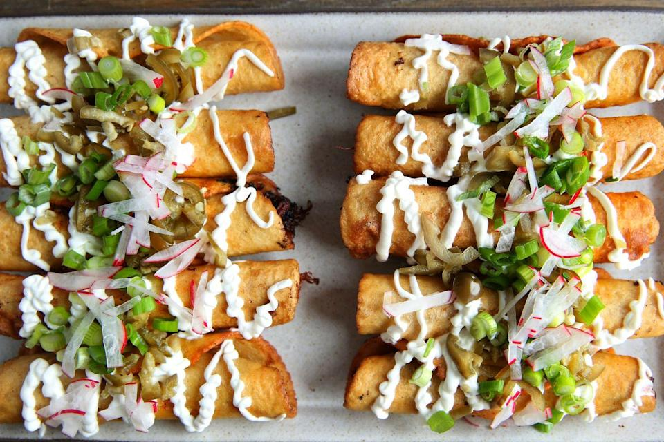 "<p>Why choose between Thai and Mexican when you can have BOTH?</p><p>Get the recipe from <a href=""/cooking/recipe-ideas/recipes/a46434/slow-cooker-thai-red-curry-taquitos-recipe/"" data-ylk=""slk:Delish."" class=""link rapid-noclick-resp"">Delish.</a><br></p>"