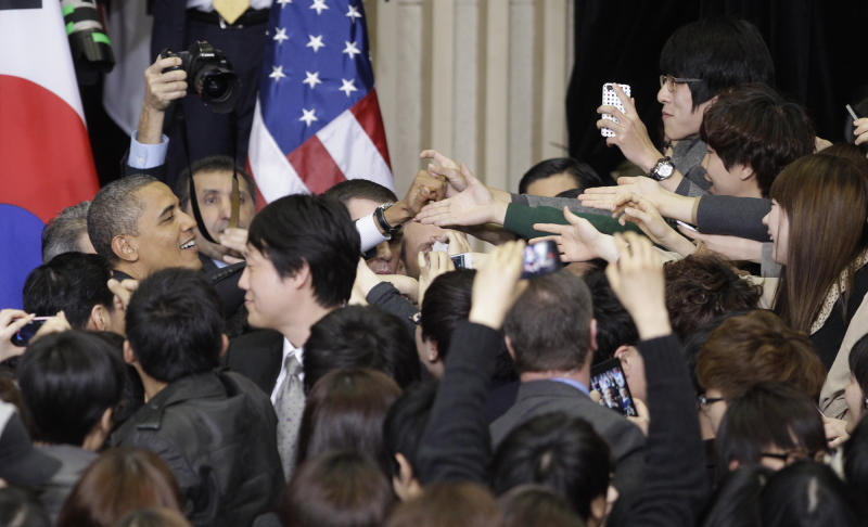U.S. President Barack Obama greets students after his speech at the Hankuk University of Foreign Studies in Seoul, South Korea, Monday, March 26, 2012. (AP Photo/Lee Jin-man)