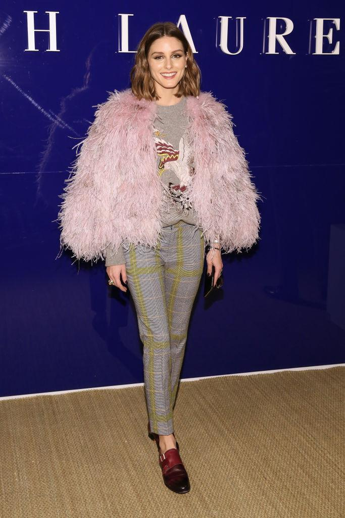 <p>FROW regular Olivia Palermo donned a faux fur jacket and checked trousers for the Ralph Lauren AW18 preview. <em>[Photo: Getty]</em> </p>