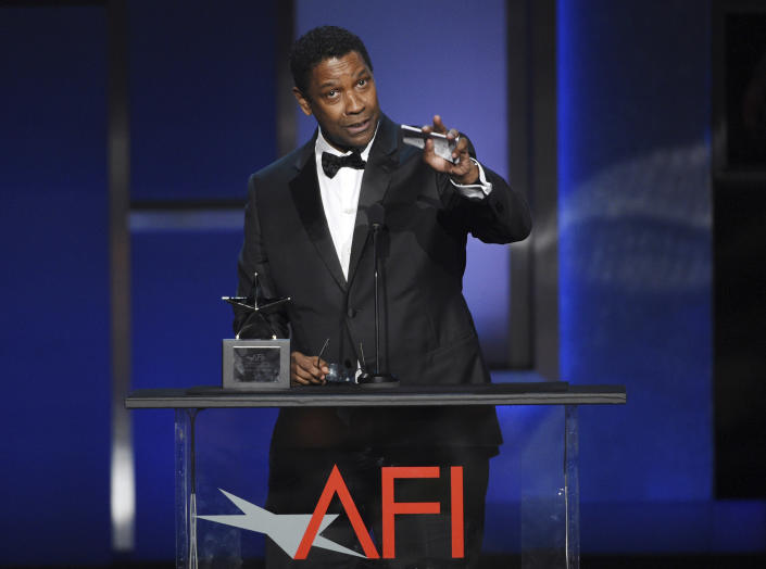 FILE - Denzel Washington addresses the audience during the 47th AFI Life Achievement Award ceremony honoring him on June 6, 2019 in Los Angeles. Washington turns 66 on Dec. 28. (Photo by Chris Pizzello/Invision/AP, File)