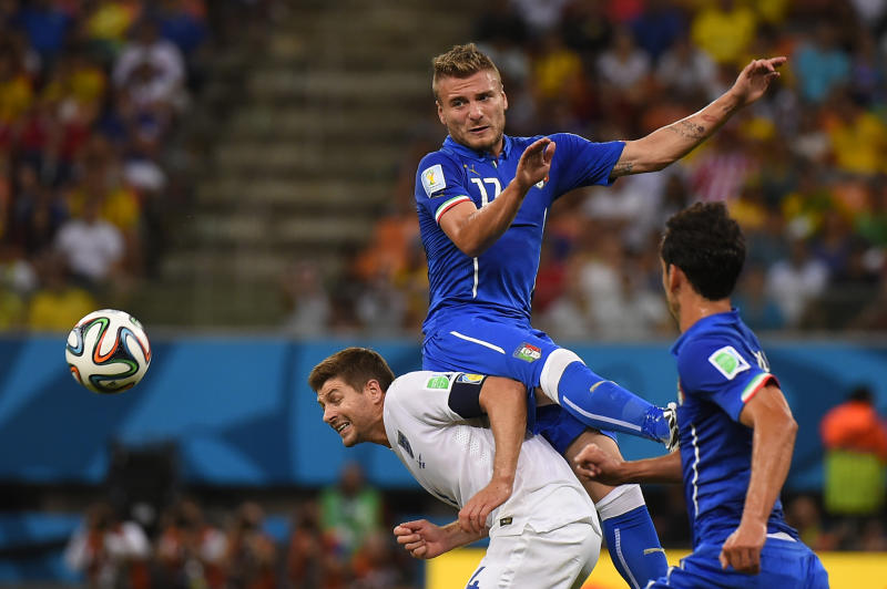 Italy forward Ciro Immobile (top) and England midfielder Steven Gerrard vie for the ball during the World Cup Group D match at the Amazonia Arena in Manaus during the 2014 FIFA World Cup on June 14, 2014
