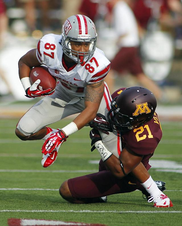 UNLV wide receiver Maika Mataele is tackled after a catch by Minnesota defensive back Brock Vereen (21) in the first quarter of their NCAA college football game, Thursday Aug. 29, 2013, in Minneapolis. (AP Photo/Andy Clayton-King)