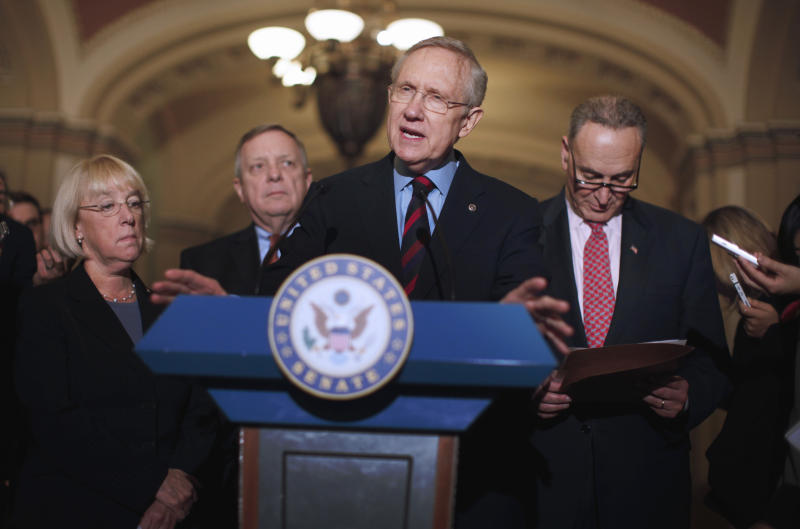 Senate Majority Leader Harry Reid of Nev.,  center, accompanied by, from left, Sen. Patty Murray, D-Wash., Senate Majority Whip Richard Durbin of Ill., and Sen. Charles Schumer, D-N.Y., speaks to reporters about extending the payroll tax cut, Thursday, Dec. 1, 2011, on Capitol Hill in Washington. (AP Photo/Charles Dharapak)
