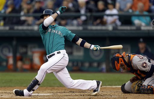 Houston Astros catcher Carlos Corporan, right, is hit by the bat of Seattle Mariners' Brendan Ryan, left, during an at-bat in the fourth inning of a baseball game, Wednesday, June 12, 2013, in Seattle. (AP Photo/Ted S. Warren)