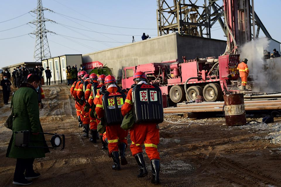 Rescuers working at the site of gold mine explosion where 22 miners were trapped underground in Qixia (AFP via Getty Images)