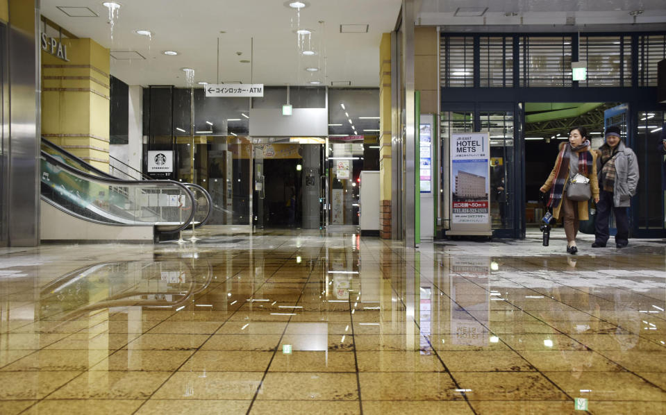 Water covers a floor of Fukushima station as it leaks from a ceiling following an earthquake in Fukushima, northeastern Japan Saturday, Feb. 13, 2021. A strong earthquake hit off the coast of northeastern Japan late Saturday, shaking Fukushima, Miyagi and other areas, but there was no threat of a tsunami, officials said. (Kyodo News via AP)