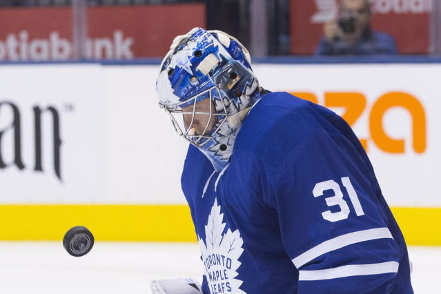 Toronto Maple Leafs goaltender Frederik Andersen watches the puck as he makes a stop during third-period NHL hockey game action against the Boston Bruins in Toronto, Monday, Nov. 26, 2018. (Chris Young/The Canadian Press via AP)