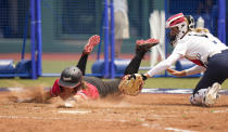 Canada's Joey Lye, left, is tagged by United States' Aubree Munro at home plate during the softball game between the United States and Canada at the 2020 Summer Olympics, Thursday, July 22, 2021, in Fukushima , Japan. (AP Photo/Jae C. Hong)