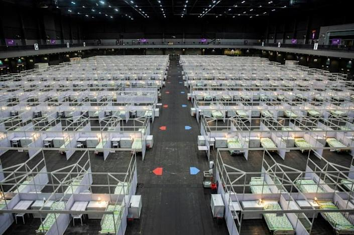 Hong Kong opened a new emergency hospital as record daily caseloads overwhelm health services (AFP Photo/ISAAC LAWRENCE)