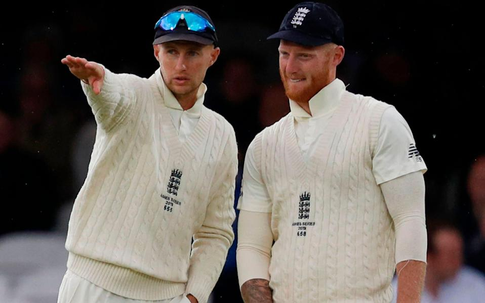 England's Ben Stokes talk between balls on the third day of the second Ashes cricket Test match between England and Australia at Lord's Cricket Ground - AFP