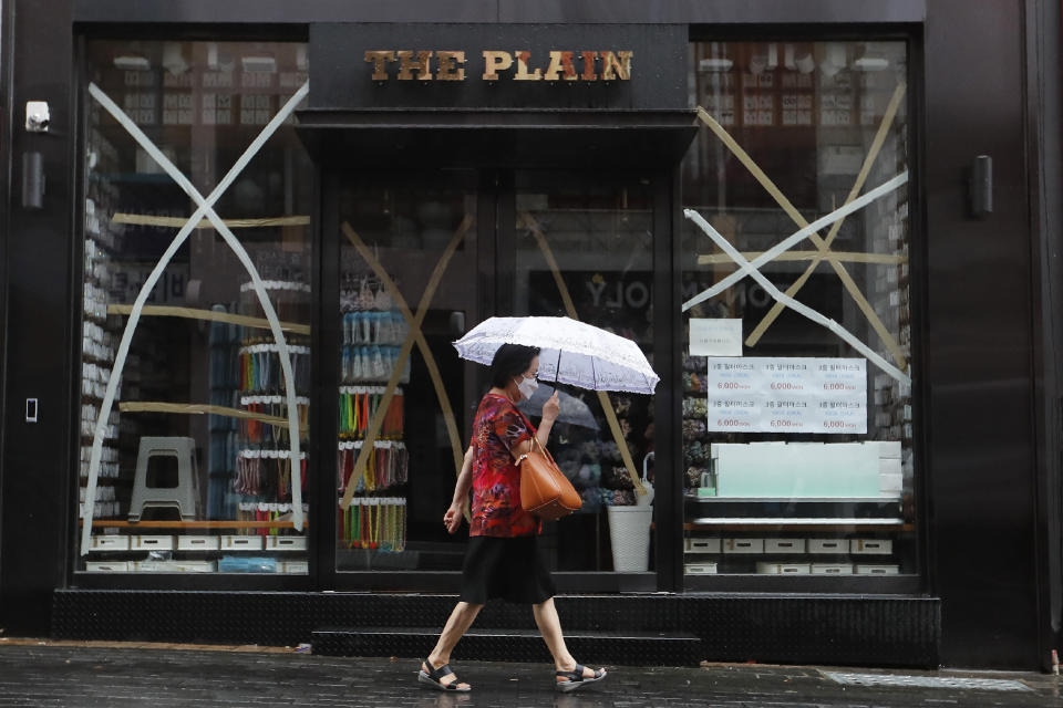 Windows of a store are taped up in preparation for Typhoon Bavi in Seoul, South Korea, Thursday, Aug. 27, 2020. Typhoon Bavi that grazed South Korea and caused some damage has made landfall in North Korea early Thursday. South Korean authorities said there were no immediate reports of casualties, and North Korea has not reported any damages. (AP Photo/Ahn Young-joon)