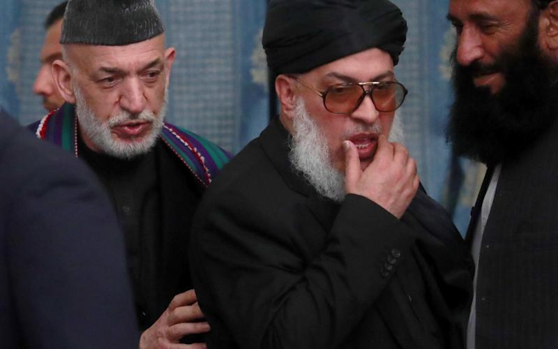 Former president Hamid Karzai (L) and the political chief of the Taliban envoy Sher Mohammad Abbas Stanikzai (2nd R) meet in Moscow - TASS