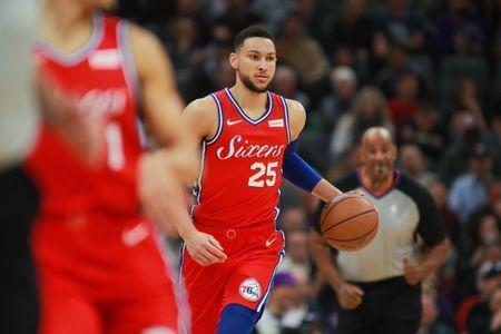 FILE PHOTO: Feb 2, 2019; Sacramento, CA, USA; Philadelphia 76ers guard Ben Simmons (25) dribbles the ball against the Sacramento Kings during the first quarter at Golden 1 Center. Mandatory Credit: Sergio Estrada-USA TODAY Sports