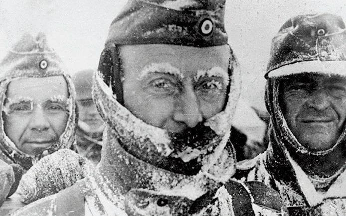Three German soldiers covered in snow and ice during winter on the Eastern front - Getty Images