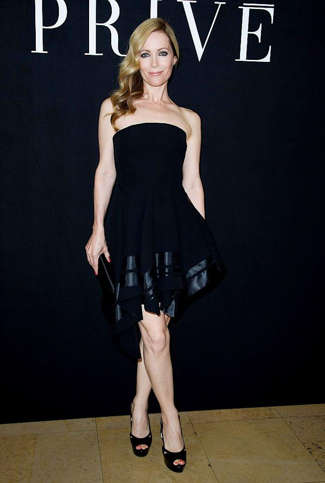 Sometimes a little black dress is all you need. Well, that and a team of stylists. Anyway, Leslie Mann got gussied up in one recently during Paris Fashion Week. In Armani. At Armani. Love it! (7/3/2012)