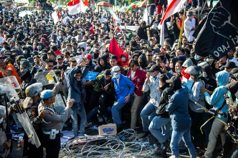 Hundreds have been injured in the protests against a major overhaul of the country's criminal code (AFP Photo/Juni Kriswanto)