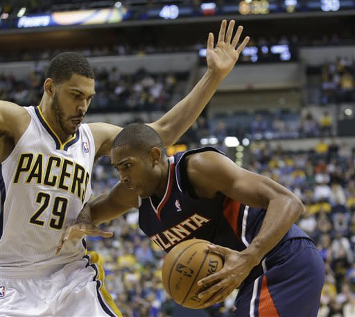 Atlanta Hawks' Al Horford, right, goes to the basket against Indiana Pacers' Jeff Pendergraph during the first half of Game 1 in the first round of the NBA basketball playoffs on Sunday, April 21, 2013, in Indianapolis. (AP Photo/Darron Cummings)