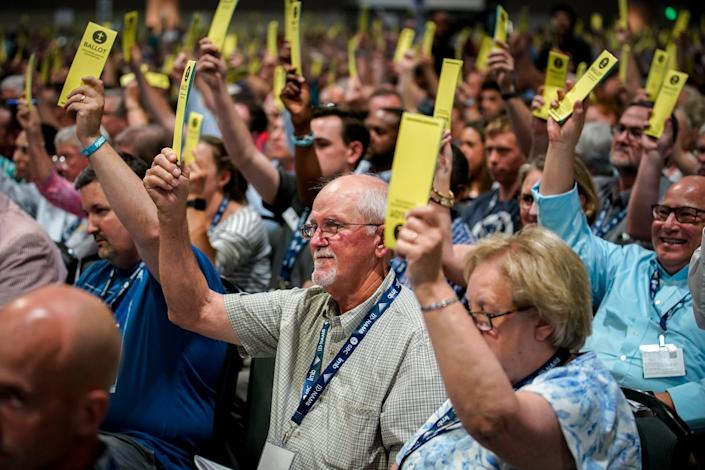 Southern Baptists vote on a resolution during the annual Southern Baptist Convention meeting at Music City Center in Nashville, Tenn.