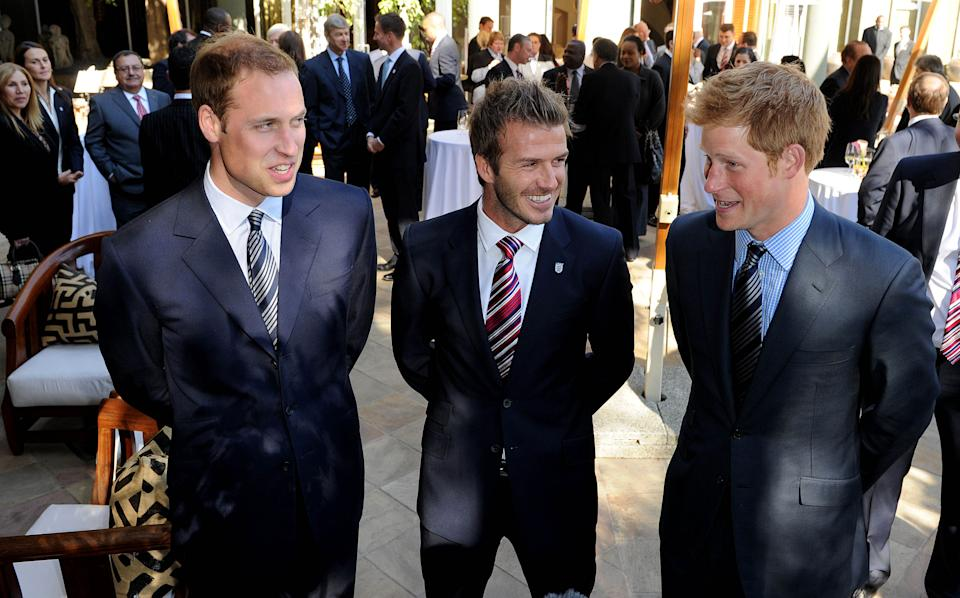 Princes William and Harry are pals with former footballer David Beckham, pictured here together in 2010 in Johannesberg, South Africa. Beckham and his wife Victoria went to both of their weddings and they have worked together on lots of sporting projects. (Photo by Luca Ghidoni - Pool/Getty Images)