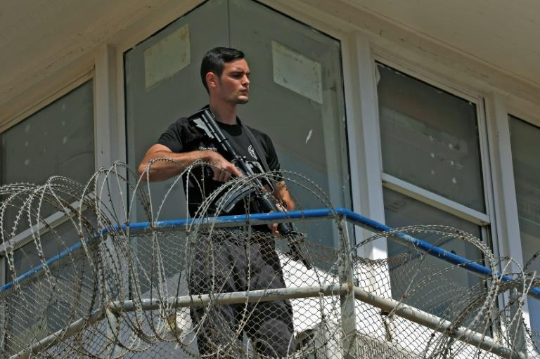 A police officer keeps watch from an observation tower at the Gilboa Prison (AFP/JALAA MAREY)