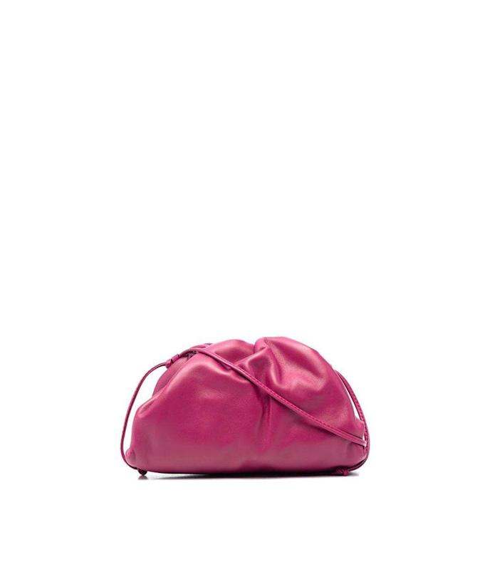 """<p><strong>Bottega Veneta</strong></p><p>ShopBAZAAR.com</p><p><strong>$1550.00</strong></p><p><a href=""""https://go.redirectingat.com?id=74968X1596630&url=https%3A%2F%2Fshop.harpersbazaar.com%2Fdesigners%2Fbottega-veneta%2Fmini-crsbody-pouch-70984.html&sref=https%3A%2F%2Fwww.harpersbazaar.com%2Ffashion%2Ftrends%2Fg35555954%2Ffall-2021-bag-trends%2F"""" rel=""""nofollow noopener"""" target=""""_blank"""" data-ylk=""""slk:Shop Now"""" class=""""link rapid-noclick-resp"""">Shop Now</a></p><p>Nothing looks more effortless than pairing a clutch with easy layers and running out the door. This one is small but mighty and can fit everything you need when on the go. </p>"""
