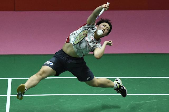 Japan's Akane Yamaguchi hits a return on her way to a straight sets victory against Thailand's Ratchanok Intanon (AFP Photo/Lillian SUWANRUMPHA )