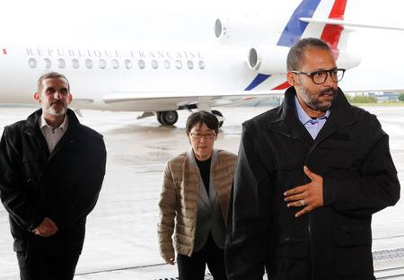 Freed French hostages Patrick Picque and Laurent Lassimouillas walk alongside a South Korean hostage upon their arrival at the Villacoublay airport, in Velizy-Villacoublay, France May 11, 2019. Francois Guillot/Pool via REUTERS