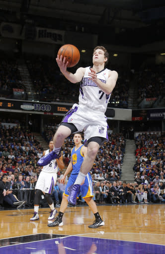 SACRAMENTO, CA - FEBRUARY 19: Jimmer Fredette #7 of the Sacramento Kings shoots against the Golden State Warriors on February 19, 2014 at Sleep Train Arena in Sacramento, California. (Photo by Rocky Widner/NBAE via Getty Images)