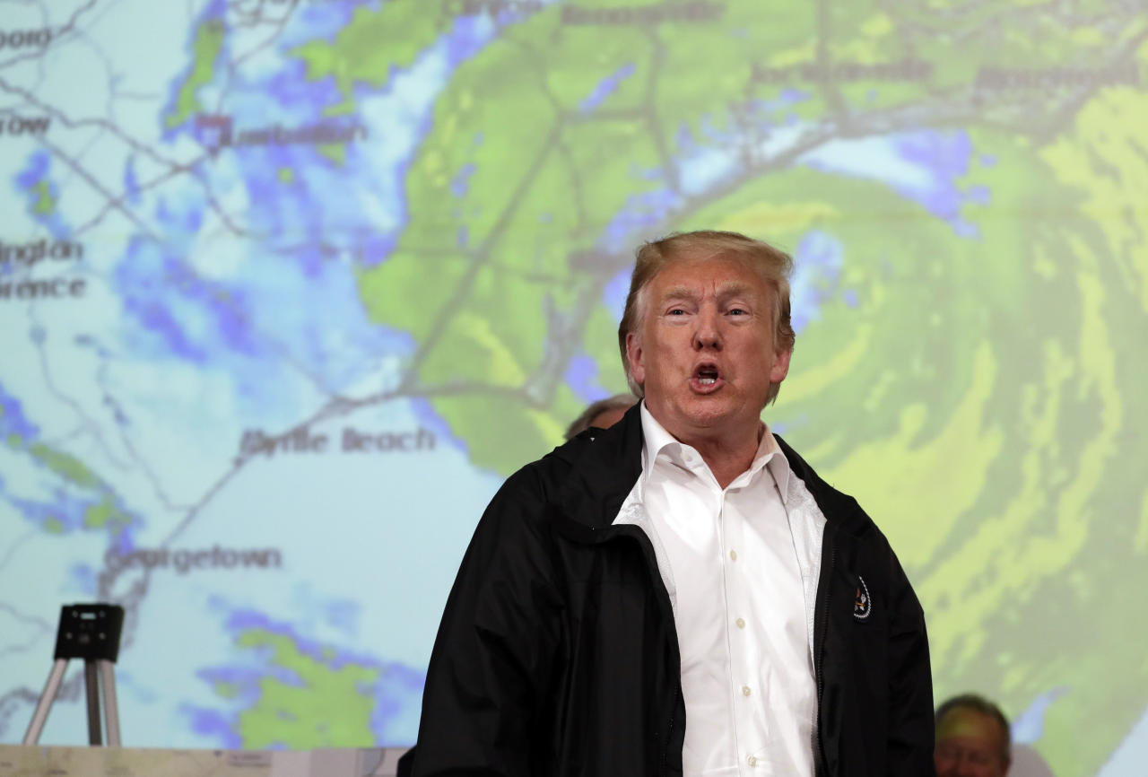 President Donald Trump gestures to first responders as he visits the Horry County Emergency Management center in the area impacted by Hurricane Florence, Wednesday, Sept. 19, 2018, in Conway, S.C. (AP Photo/Evan Vucci)