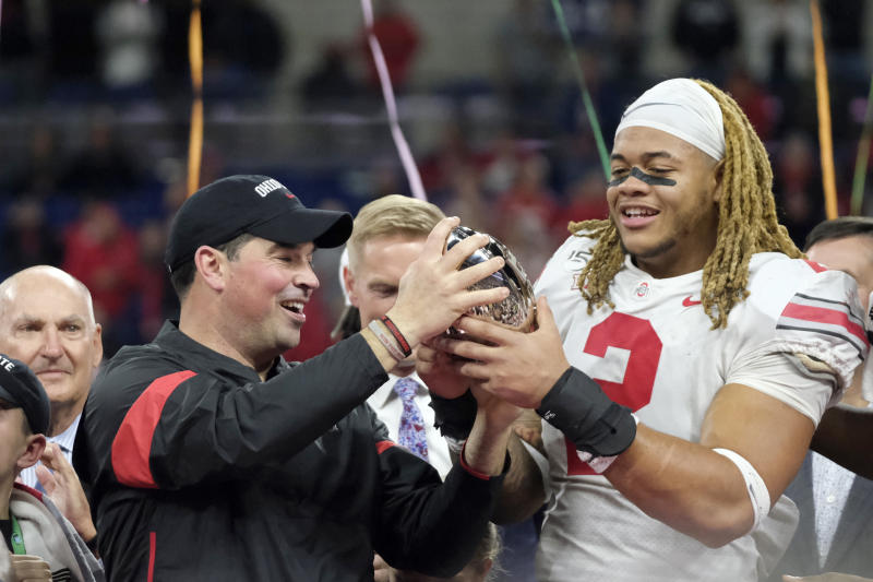 FILE - In this Dec. 8, 2019, file photo, Ohio State coach Ryan Day, left, and defensive end Chase Young (2) hold the trophy following the team's Big Ten championship NCAA college football game against Wisconsin, in Indianapolis. Ryan Day was named the Big Ten Coach of the Year and Chase Young was selected to The Associated Press All-Big Ten Conference football team, Wednesday, Dec. 11, 2019. (AP Photo/AJ Mast, File)