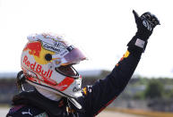 Red Bull driver Max Verstappen of the Netherlands waves to fans after finishing first in the Sprint Qualifying of the British Formula One Grand Prix, at the Silverstone circuit, in Silverstone, England, Saturday, July 17, 2021. The British Formula One Grand Prix will be held on Sunday. (Lars Baron/Pool via AP)