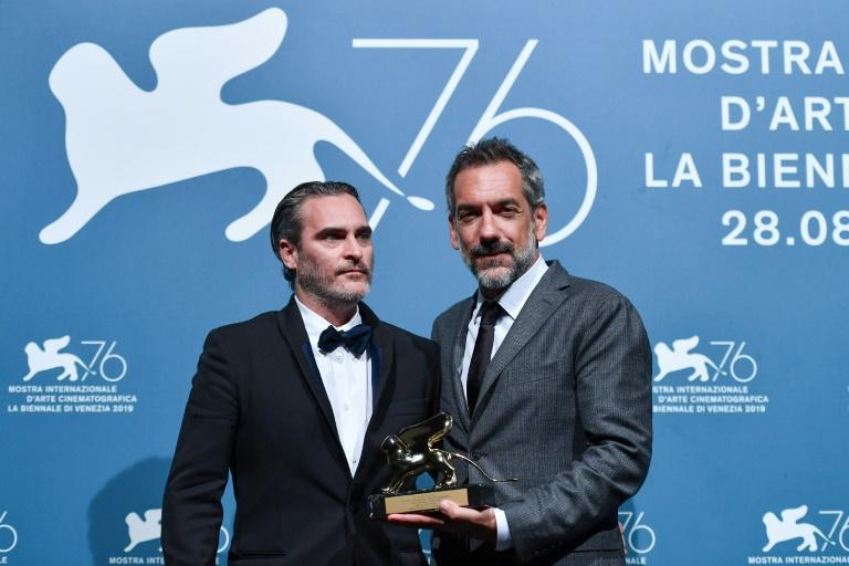America director Todd Phillips and Joaquin Phoenix collect the Golden Lion award for 'Joker' which was voted Best Film at the 2019 Venice Film Festival