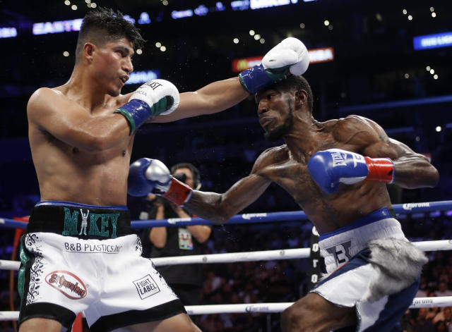 Mikey Garcia, left, exchanges punches with Robert Easter Jr. during the WBC and IBF lightweight title bout in Los Angeles, Saturday, July 28, 2018. Garcia won the bout. (AP Photo/Alex Gallardo)