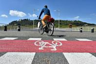 The Italian government is offering up to 500 euros ($600) to people buying a new or second-hand bike or scooter