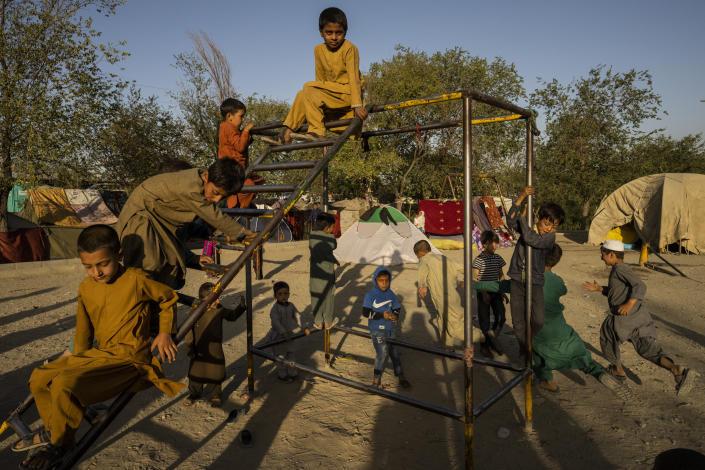 Afghan displaced children play at an internally displaced persons camp in Kabul, Afghanistan, Monday, Sept. 13, 2021. (AP Photo/Bernat Armangue)