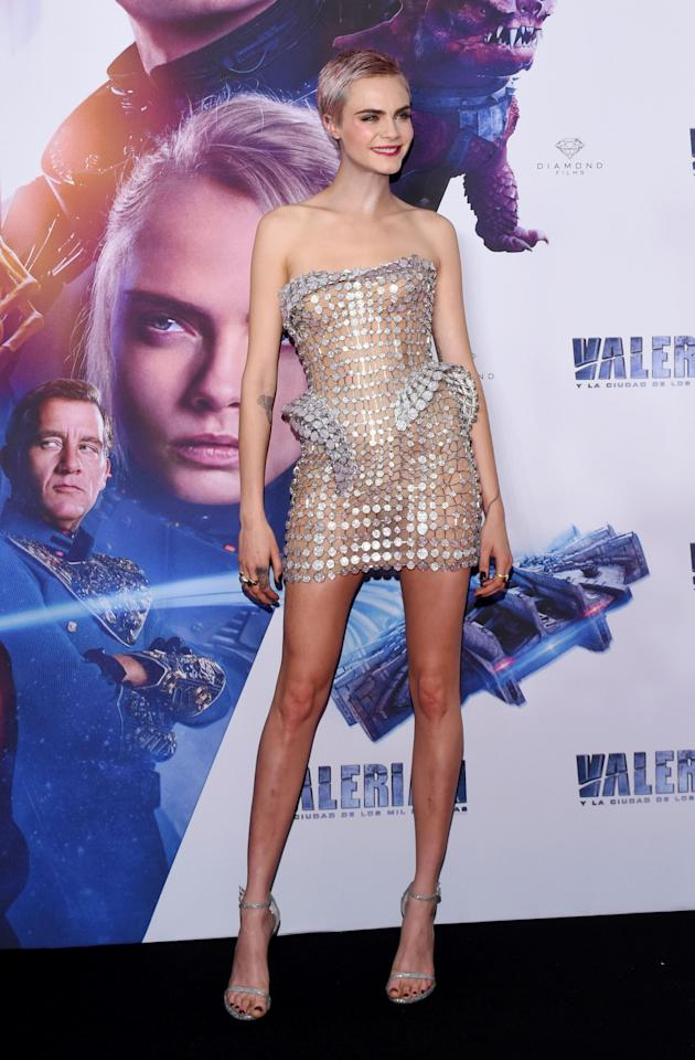 <p>For the film's Mexico premiere, Cara slipped into a semi-sheer mini dress by Italian label Atelier Versace, which she teamed with strappy heels and a bold lip. <br /><em>[Photo: Rex]</em> </p>