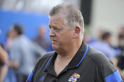 Charlie Weis was let go from Kansas on Sunday after a 2-2 start. (USA Today)