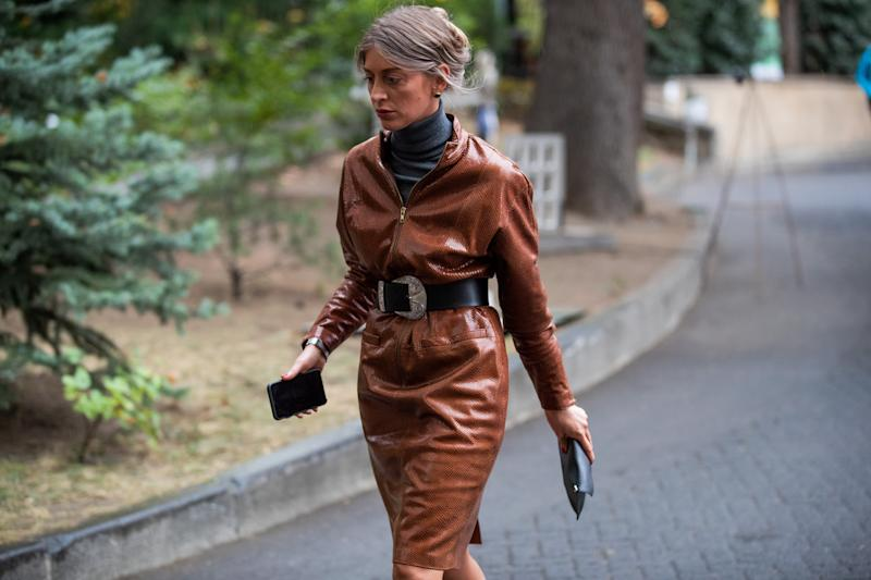TBILISI, GEORGIA - OCTOBER 31: A guest is seen wearing brown belted coat during day 1 of the Mercedes-Benz Tbilisi Fashion Week on October 31, 2019 in Tbilisi, Georgia. (Photo by Christian Vierig/Getty Images)