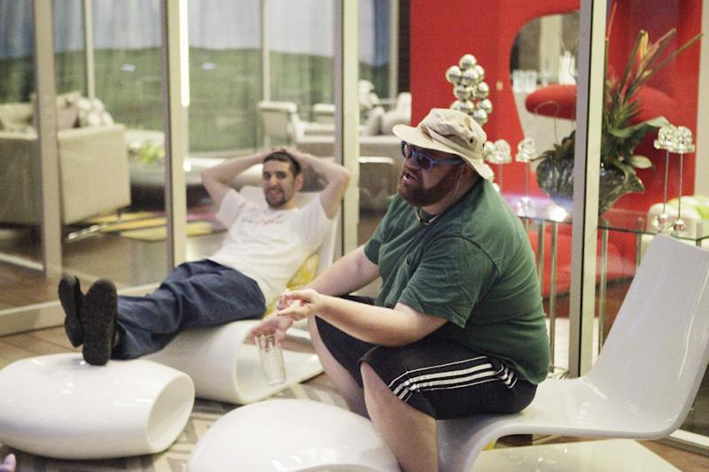 """This June 18, 2012 photo released by ABC shows contestants Apollo, left, and Jeffrey are shown during the premiere episode of """"The Glass House."""" A federal judge on Friday sided with ABC that """"Glass House"""" does not violated rival network CBS' copyright and trade secret interests and that the """"Big Brother"""" network is unlikely to win the case. (AP Photo/ABC, Nicole Wilder)"""