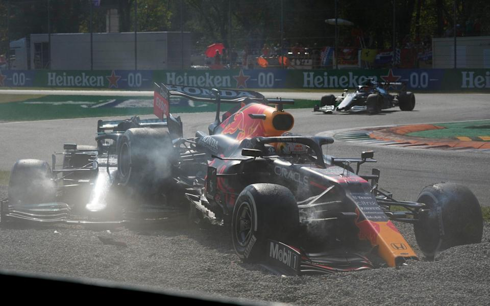 Red Bull driver Max Verstappen of the Netherlands, right and Mercedes driver Lewis Hamilton of Britain crash during the Italian Formula One Grand Prix, at Monza racetrack, in Monza, Italy - - AP