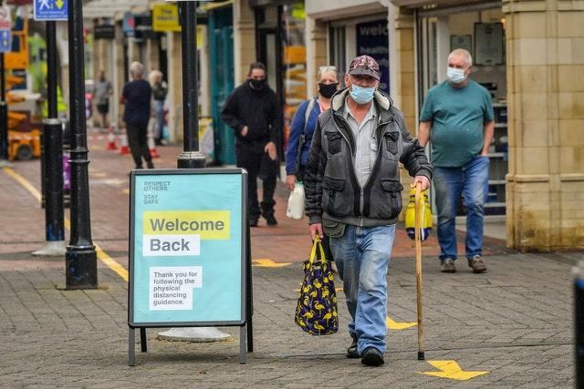 Shoppers wearing masks in Caerphilly (Ben Birchall/PA)