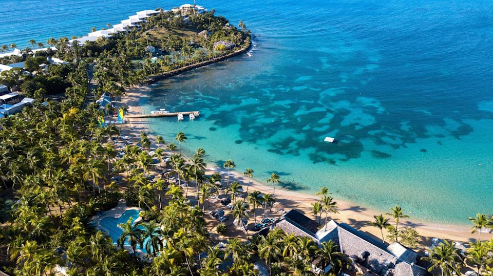"""<p><strong>Best for:</strong> Those who like to return to the same place year after year</p> <p><a href=""""https://www.cntraveler.com/hotels/antigua-and-barbuda/cades-bay/curtain-bluff-antigua?mbid=synd_yahoo_rss"""" rel=""""nofollow noopener"""" target=""""_blank"""" data-ylk=""""slk:Curtain Bluff"""" class=""""link rapid-noclick-resp"""">Curtain Bluff</a> will reopen on October 24 after closing due to COVID-19, and for families who have been coming to this laidback, family-run resort in Antigua for generations, the reopening feels just like coming home—if your home had two <a href=""""https://www.cntraveler.com/gallery/beaches-that-will-make-you-forget-about-winter?mbid=synd_yahoo_rss"""" rel=""""nofollow noopener"""" target=""""_blank"""" data-ylk=""""slk:beaches"""" class=""""link rapid-noclick-resp"""">beaches</a> (one for surf and one for swim, naturally) and nothing but oceanfront rooms, that is. For those averse to hectic schedules, this West Indies retreat is an ideal spot. Families can snorkel, sail, or swim all day, or take the lazy route at the beach or the on-site jungle gym. There are in activities ranging from bocce ball and tennis clinics to cocktail making (with mocktails for the kids). Either way, there are always early 6 p.m. dinners for hungry kiddos and on-site babysitters are available for an extra cost, which frees up evenings for parents to enjoy a little romance, dining by candlelight at the Tamarind Restaurant and tuning into nightly live music.</p> <p><strong>Book now:</strong> Doubles from $900 per night, <a href=""""https://prf.hn/l/Kj05kw1"""" rel=""""nofollow noopener"""" target=""""_blank"""" data-ylk=""""slk:expedia.com"""" class=""""link rapid-noclick-resp"""">expedia.com</a></p>"""