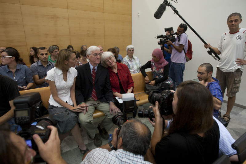 Cindy, center right, and Craig Corrie, center, the parents of Rachel Corrie, a pro-Palestinian activist who was killed by an Israeli bulldozer in Gaza in 2003, sit together with their daughter Sarah, center left, in the court room just before the district court's ruling in Haifa, Israel,Tuesday, Aug. 28, 2012. An Israeli court on Monday rejected a lawsuit brought against the military by the parents of a U.S. activist crushed to death by an army bulldozer during a 2003 demonstration, ruling the army was not at fault for her death. The bulldozer driver has said he didn't see 23-year-old Rachel Corrie, who was trying to block the vehicle's path during a demonstration in the Gaza Strip against the military's demolition of Palestinian homes. The military deemed her March 2003 death to be accidental, but Corrie's parents were not satisfied by the army investigation and filed a civil lawsuit two years later. (AP Photo/Ariel Schalit)