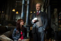 """This film publicity image released by Screen Gems shows Lilly Collins as Clary, left, and Jared Harris as Hodge Starkweather in a scene from """"The Mortal Instruments: City of Bones. (AP Photo/Sony Pictures Screen Gems, Rafy)"""