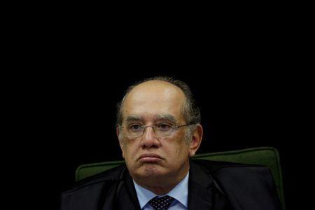 Judge Gilmar Mendes looks on during a meeting of the Brazilian Supreme Court to vote on whether to ask for the arrest of Senator Aecio Neves in Brasilia