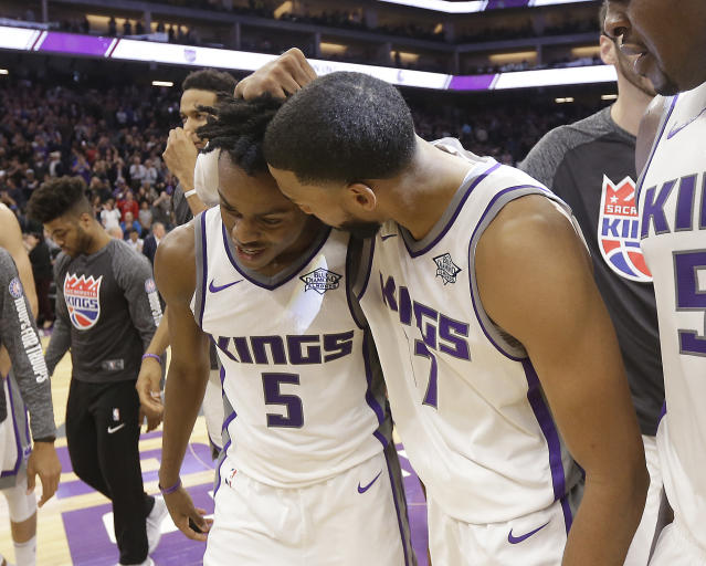 Garrett Temple (right) congratulates rookie De'Aaron Fox for hitting the game-winning jumper that pushed the Kings past the 76ers. (AP)