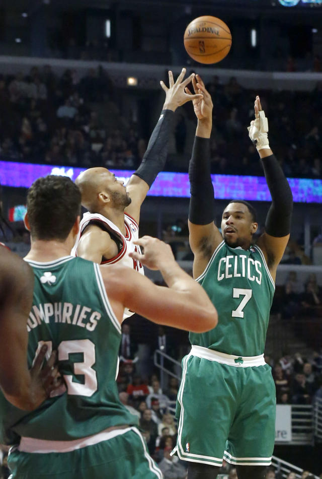 Boston Celtics forward Jared Sullinger (7) shoots over Chicago Bulls Taj Gibson as Celtics' Kris Humphries (43) watches during the first half of an NBA basketball game on Thursday, Jan. 2, 2014, in Chicago. (AP Photo/Charles Rex Arbogast)