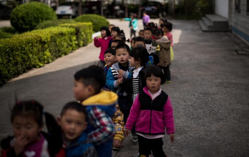 Children in the playground of the Technical Secondary School in Rudong, Jiangsu province. Strict birth control policies have left a dwindling child population (AFP Photo/Johannes Eisele )