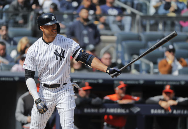 FILE - In this Saturday, March 30, 2019 file photo, New York Yankees right fielder Giancarlo Stanton waits for the pitch against the Baltimore Orioles during the fourth inning of a baseball game in New York. Giancarlo Stanton wants to return from his knee injury in time to fine-tune that powerful swing for October. Sidelined nearly all season, the New York Yankees slugger is hitting indoors and throwing as he rehabs from a sprained right knee that's been slow to heal since he got hurt June 25. (AP Photo/Julie Jacobson, File)