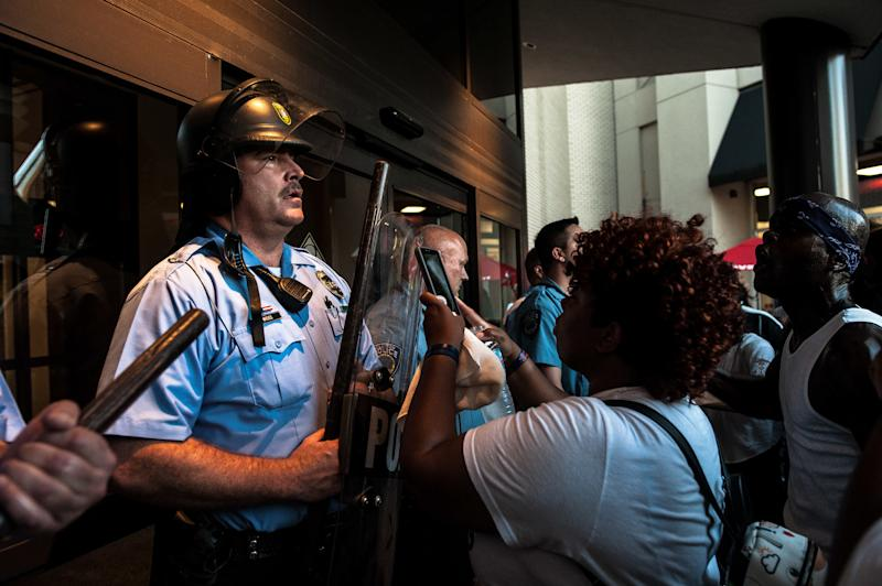 Riot police guard the entrance to the St. Louis Galleria, where protesters gathered on Wednesday. (Joseph Rushmore for HuffPost)